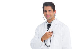 Happy doctor holding up stethoscope to his chest Stock Images