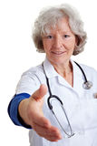 Happy doctor offering handshake Royalty Free Stock Photography