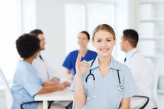 Happy doctor over group of medics at hospital Stock Photo