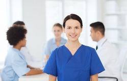 Happy doctor over group of medics at hospital Stock Image