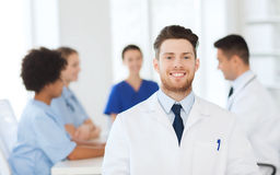 Happy doctor over group of medics at hospital Royalty Free Stock Images