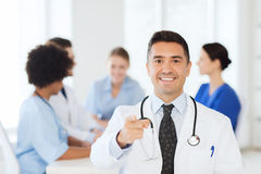 Happy doctor over group of medics at hospital Royalty Free Stock Photo