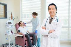 Happy Doctor With Patient Being Examined By Stock Photo