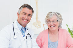 Happy doctor and patient in clinic Royalty Free Stock Photo