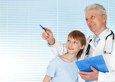 Happy doctor with patients Royalty Free Stock Images