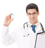 Happy doctor with pill, isolated Stock Photos