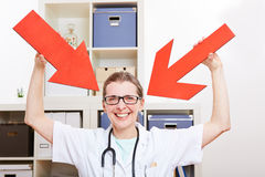 Happy doctor pointing arrows Stock Images