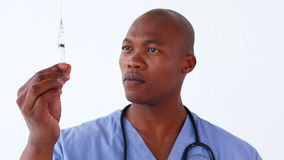 Happy doctor preparing a syringe stock video footage