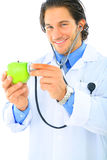 Happy Doctor Promoting Healthy Eating Royalty Free Stock Photography