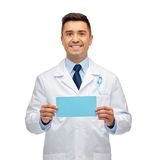 Happy doctor with prostate cancer awareness ribbon Royalty Free Stock Image