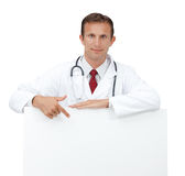 Happy doctor showing blank board sign. Stock Image