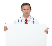 Happy doctor showing blank board sign. Royalty Free Stock Photography