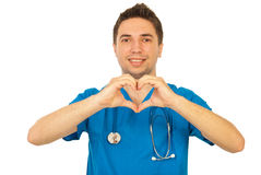 Happy doctor showing heart shape royalty free stock photography