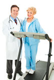 Happy Doctor and Sr Woman Stock Photography