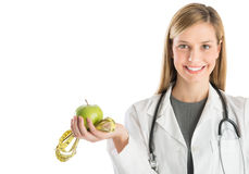 Happy Doctor With Stethoscope Showing Smith Apple And Tape Measu Stock Photos