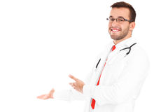Happy doctor with stethoscope showing your product Stock Photos