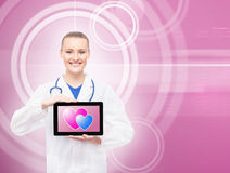 Happy doctor with a tablet and hearts on it Stock Photos