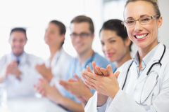 Happy doctor and team clapping Royalty Free Stock Photo