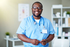 Happy doctor. In uniform looking at camera in clinic Royalty Free Stock Photo