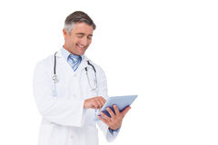 Happy doctor using tablet pc Royalty Free Stock Photos