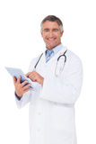 Happy doctor using tablet pc Stock Photo
