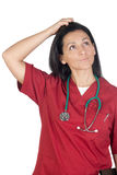 Happy doctor woman with burgundy clothing thinking Stock Images