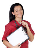 Happy doctor woman with clipboard in blank Stock Images
