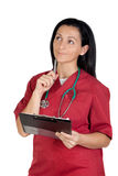 Happy doctor woman with clipboard thinking Stock Photo