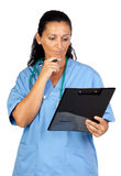 Happy doctor woman with clipboard thinking Stock Image