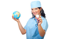 Happy doctor woman with globe and stethoscope Stock Photo