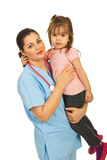 Happy doctor woman holding toddler Stock Photos