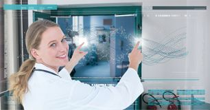 Happy doctor woman interacting with DNA interface Royalty Free Stock Image