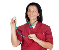 Happy doctor woman listening with stethoscope Stock Image