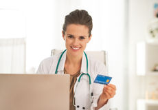 Happy doctor woman making online shopping Stock Image