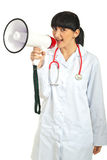 Happy doctor woman with megaphone Stock Photo