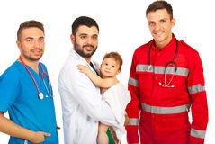 Happy doctors with baby boy royalty free stock images