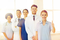 Happy doctors showing thumbs up at hospital Royalty Free Stock Photography