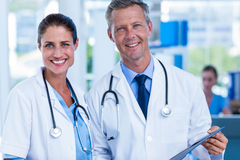 Happy doctors smiling at camera Royalty Free Stock Images