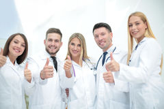 Happy doctors smiling and showing thumbs up. Stock Photography