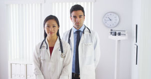 Happy doctors standing in office Stock Images