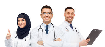 Happy doctors with stethoscopes showing thumbs up Stock Photos