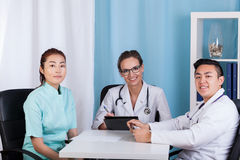 Happy doctors talking in the office Stock Photography