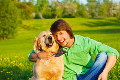Happy dog and man in the park together Royalty Free Stock Photography