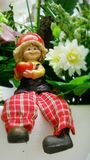Happy doll in the flower garden Royalty Free Stock Photography