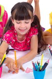 Happy drawing girl stock image