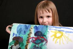 Happy drawing girl Stock Images