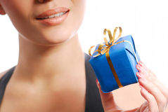 Happy dream... Blue box with yellow ribbon.... Huppy woman on the background Royalty Free Stock Photography