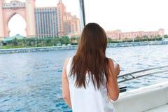 Dreamer Girl. Happy Dreamer cute beautiful girl at yacht with sun glasses ., Dubai stock images