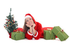 Happy dreaming santa with tree and presents Stock Photography
