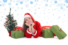 Happy dreaming santa with tree and presents Royalty Free Stock Images